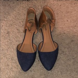 Navy blue and tan flats